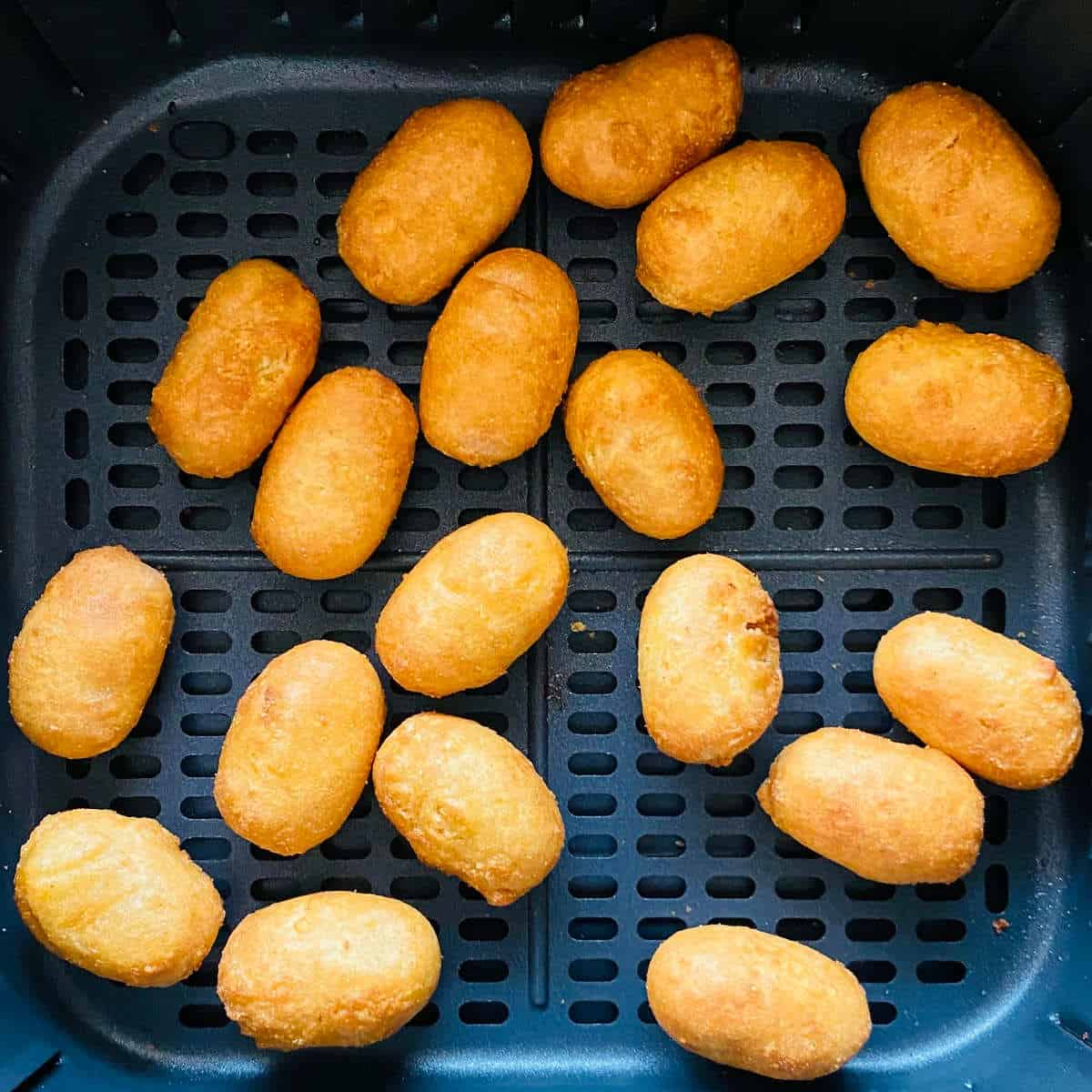 air fryer mini corn dogs cooked in air fryer basket