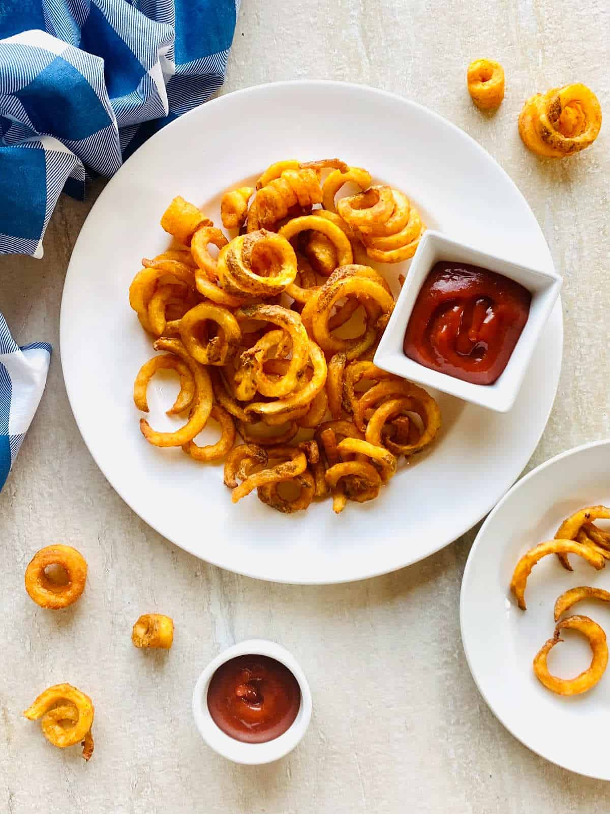 air fryer curly fries on plate with ketchup