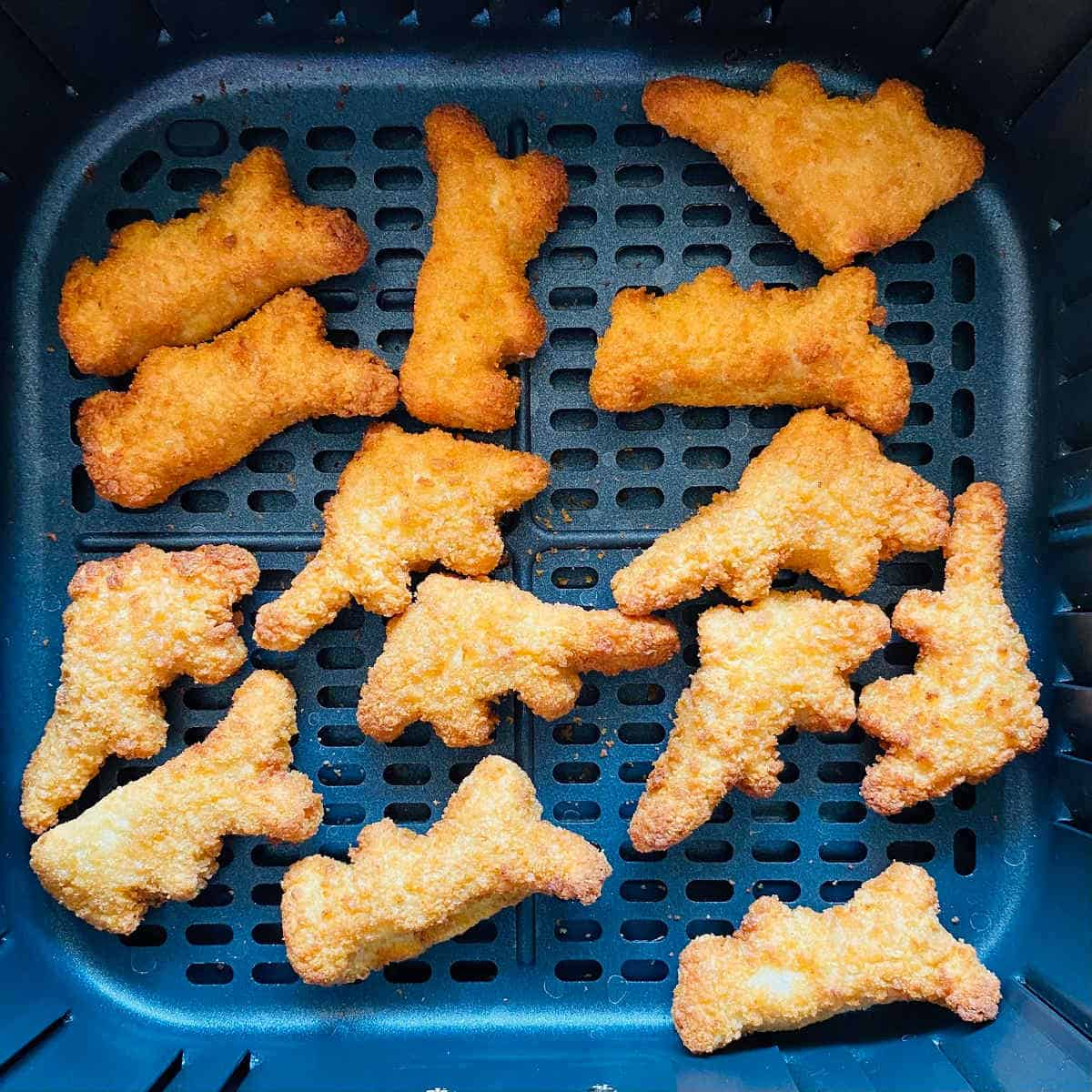 cooked dino nuggets in air fryer basket
