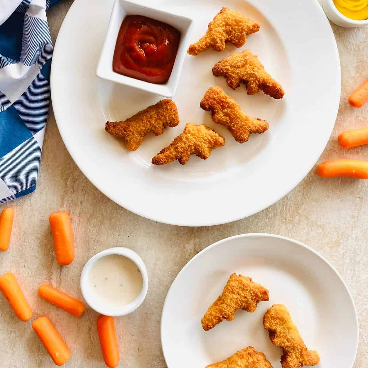 air fryer yummy dino buddies on a plate with carrots and dipping sauce